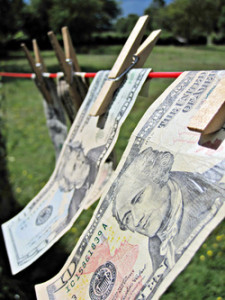 """Side View of Dollar Bills on the Washing Line"" by Images Money"